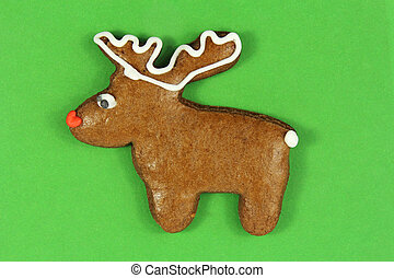 christmas reindeer gingerbread on green background
