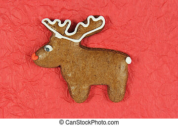 christmas reindeer gingerbread on red background