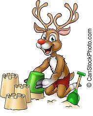 Christmas Reindeer Making Beach Sandcastles - Christmas...