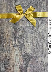 Christmas ribbon on wood background