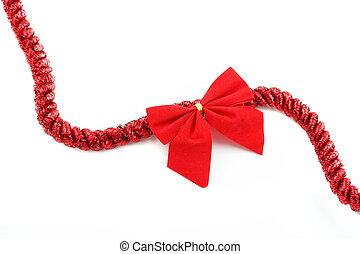 christmas ribbon - red christmas tinsel and bow on a white ...