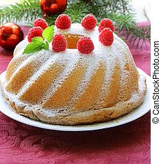 Christmas round sponge cake with raspberries