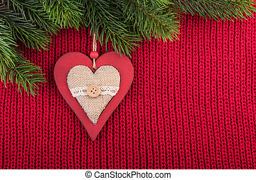 Christmas Rustic Decoration on Red Knitted Background