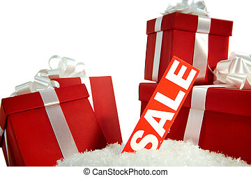 Christmas sale and gifts - A heap of Christmas gifts in snow...