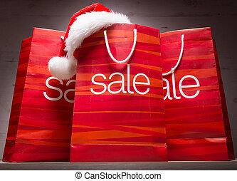 Christmas - Sale bag , rebate ,on wood background