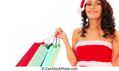Christmas sale for shopping woman in Santa hat holding bag.