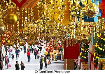 Christmas Sale. Huge shop, hung with golden Christmas balls...