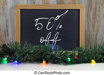 Christmas sale sign on chalkboard