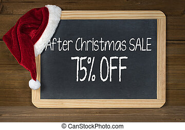 Christmas sale sign on chalkboard with hat