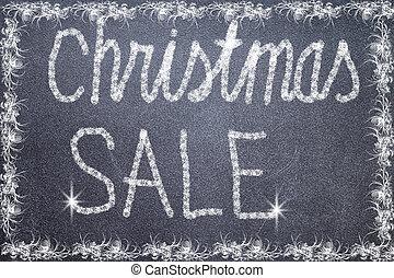 Christmas sale text written on chalkboard