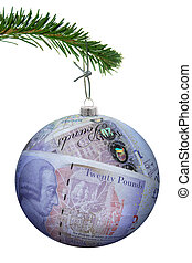 Christmas bauble made of pound banknotes hanging from a tree