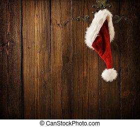 Christmas Santa Claus Hat Hanging On Wood Wall, Xmas Concept...