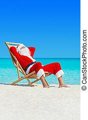 Christmas Santa Claus relax in deckchair at ocean sandy...