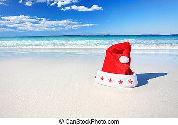 Christmas Santa hat on sunny beach in Australia - Christmas...