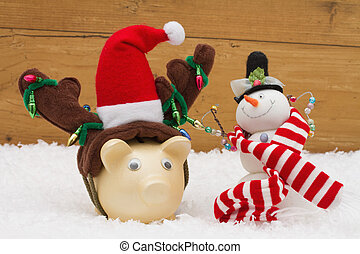 Christmas Savings, Piggy Bank and Snowman with scarf on snow