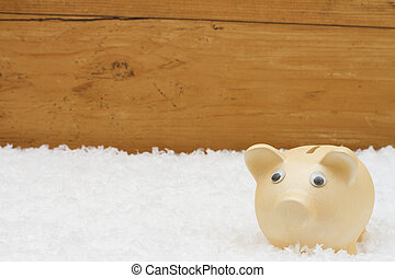 Christmas Savings, Piggy Bank on snow with copy-space