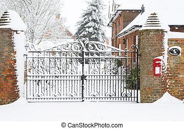 Christmas scene house gates in snow