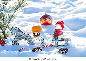 Christmas Scene. snowman sitting on a sled