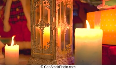 Christmas scene with burning candles.