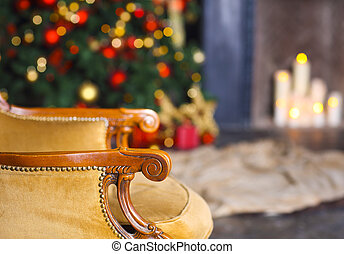 Christmas scene with chair tree gifts and fireplace in background