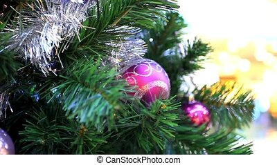 Christmas scene with tree and colordul balls, close-up....