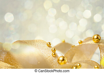 Christmas seasonal background with ribbon and golden beads
