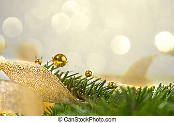Christmas seasonal background with spruce and golden beads