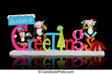 A Christmas Season's Greeting sign with cute penguins over black background