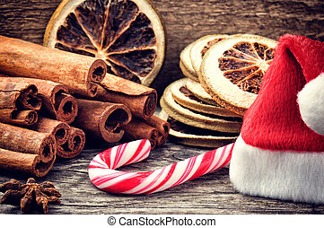 Christmas setting with festive spices and candy cane -...