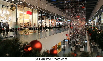 Christmas shoping mania - Christmas decorated shop with two...