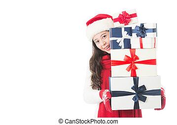Christmas shopping asian woman holding many Christmas gifts
