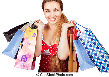 Christmas shopping concept - woman with present bags