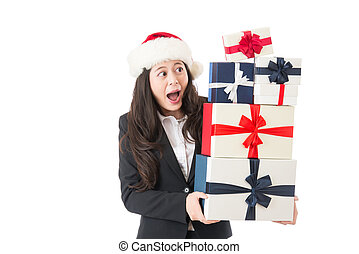 excited business woman holding many Christmas gifts