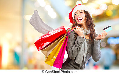 Christmas Shopping. Girl With Credit Card In Shopping Mall.Sales