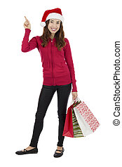 Christmas shopping woman pointing at copy space