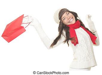 Christmas shopping woman with gift bag