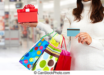 Christmas shopping woman with gift.