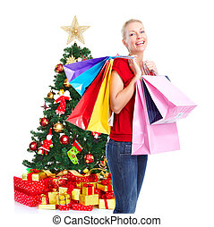 Christmas shopping woman with gifts.