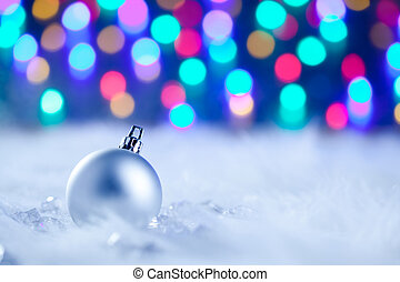 Christmas silver bauble in blurred lights - Christmas silver...