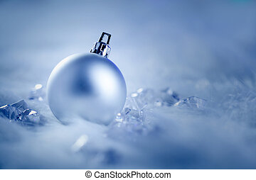 christmas silver bauble on fur snow and ice