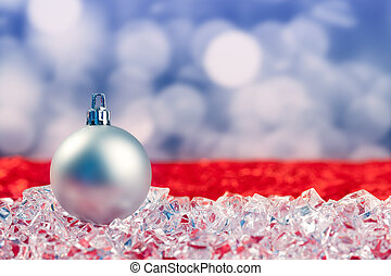 Christmas silver bauble on ice cubes