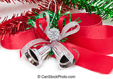 Christmas silver bell with red ribbon isolated on white background