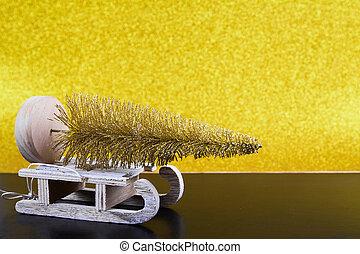 Christmas sled on gold background