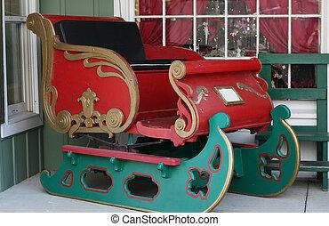 Christmas sleigh - Red and green christmas sleigh on porch...