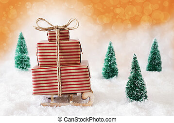 Christmas Sleigh With Orange Background On Snow
