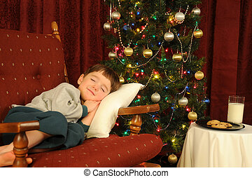 Christmas Slumber - A little boy falls asleep while waiting ...