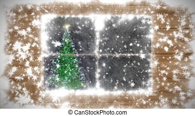 The snow-covered window, falling snow and New Year tree