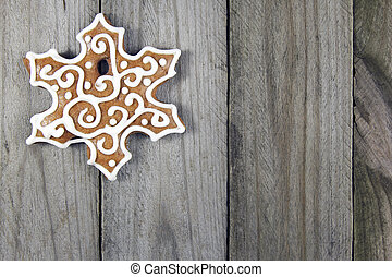christmas snowflake gingerbread on wooden background