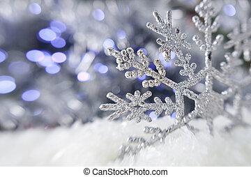 Christmas snowflake on the lights background