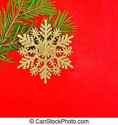 Christmas snowflake with sprigs of spruce